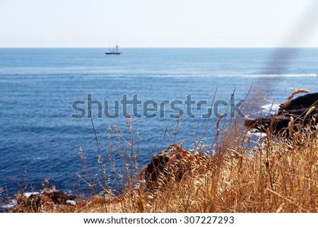sky rock sea shore landscape - stock photo