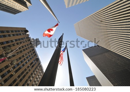 Sky scrapers with flags of different countries reaching for the sky. - stock photo