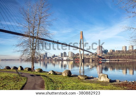 Sky-train bridge linking Surrey and New Westminster over the Fraser River British Columbia  - stock photo