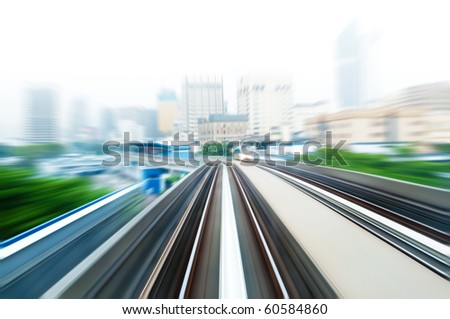 Sky Train moving fast in a hazy city. - stock photo
