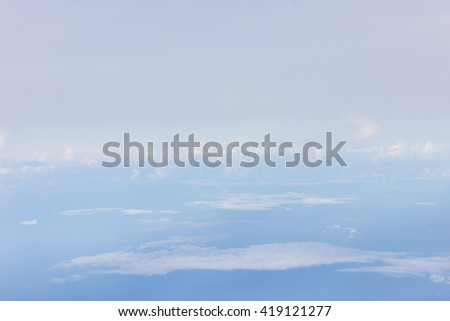 Sky view from an airplane window - stock photo