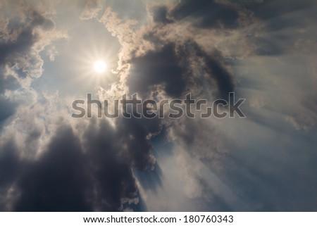 Sky with clouds and shine sun. Sun rays. - stock photo