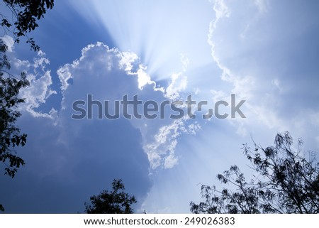 Sky with clouds and the sun shines a beam beautiful sky - stock photo