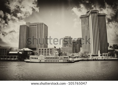 Skycrapers of New Orleans with Mississippi River - stock photo