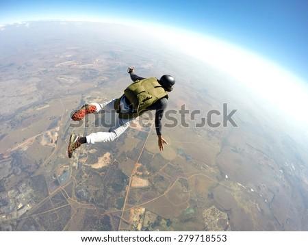 Skydiver flies through the air - stock photo