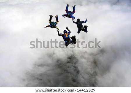 Skydivers doing formations - stock photo