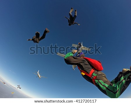 Skydivers jumping from the plane - stock photo