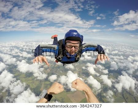 Skydiving caucasian man - stock photo