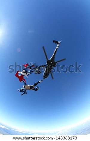 Skydiving Exit from helicopter - stock photo