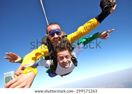Skydiving tandem boys happiness - stock photo