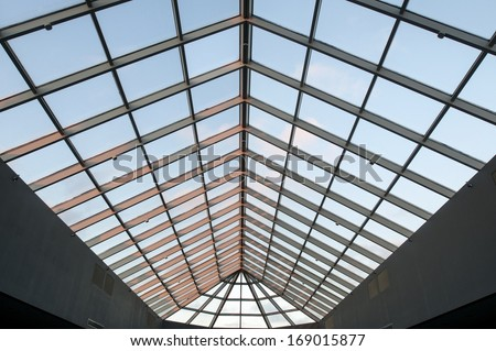 Skylight ceiling at dusk in commercial office or industrial building - stock photo