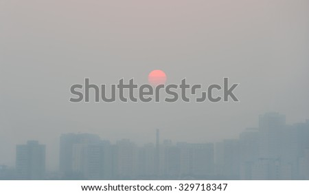 Skyline and air pollution in Beijing city - China - stock photo