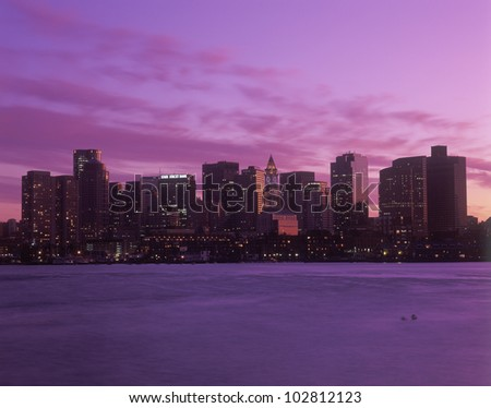 Skyline and harbor view of Boston, Massachusetts at sunset - stock photo