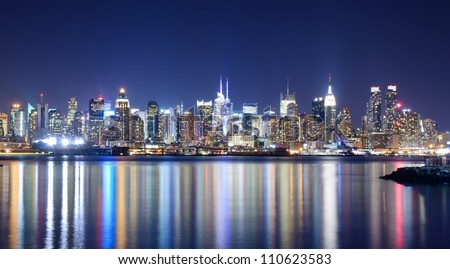 Skyline and modern office buildings of Midtown Manhattan viewed from across the Hudson River. - stock photo