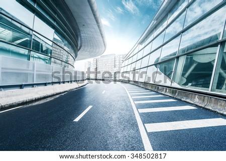 skyline,empty asphalt road passing by modern buildings  - stock photo