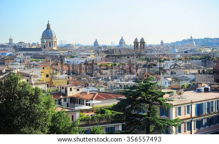 Skyline of an Old Town of Rome at sunset. Italy - stock photo