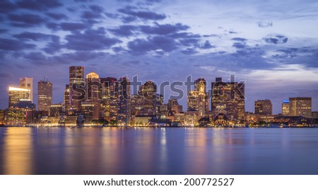 Skyline of Boston in Massachusetts, USA at sunset showcasing the architecture of its skyscrapers and a dramatic sky. - stock photo