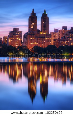 Skyline of buildings along Central Park West viewed from above Jackie Kennedy Onassis Reservoir in New York City. - stock photo