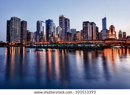 Skyline of Chicago from the Navy Pier at sunset - stock photo