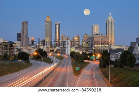 Skyline of downtown Atlanta, Georgia from above Freedom Parkway with a full moon. - stock photo