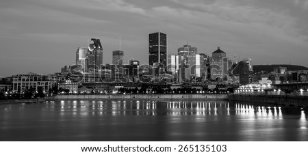 Skyline of downtown Montreal, behind the St Lawrence River,view from the Pierre-Dupuy Street at dusk. - stock photo