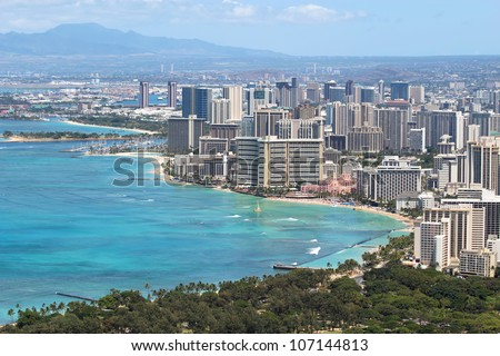 Skyline of Honolulu, Hawaii and the surrounding area including the hotels and buildings on Waikiki Beach - stock photo