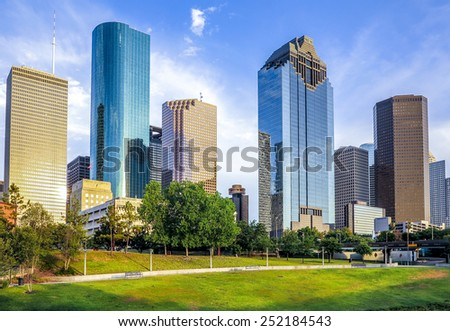 skyline of houston in bright sunset - stock photo