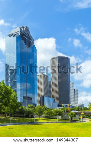 Skyline of Houston, Texas in daytime under blue sky - stock photo