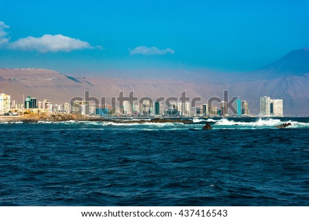 Skyline of Iquique viewed from the ocean - stock photo