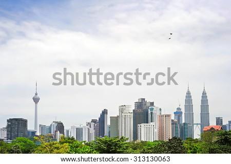 Skyline of Kuala Lumpur downtown in the day. Malaysia - stock photo