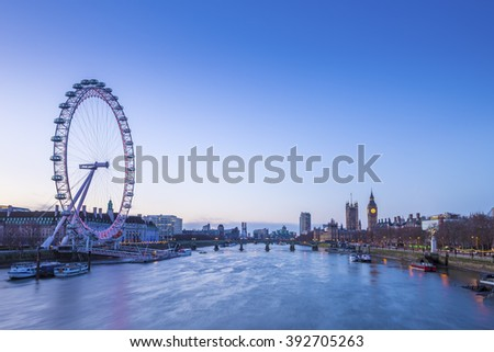 Skyline of London before sunrise with famous landmarks, Big Ben, Houses of Parliament, boat and clear blue sky - London, UK - stock photo