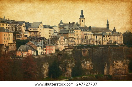 Skyline of Luxembourg City. Photo in retro style.  Added paper texture - stock photo