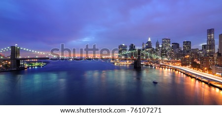 Skyline of Manhattan and Brooklyn Bridge in New York City. - stock photo
