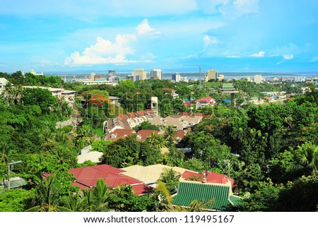 Skyline of Metro Cebu from Taoist temple. Metro Cebu is the Philippines second most significant metropolitan centre and main domestic shipping port. - stock photo
