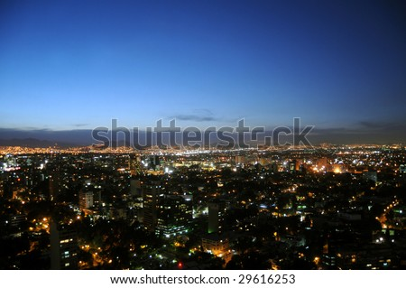 Skyline of Mexico City at twilight, shot from Colonio Polanco district towards northwest. - stock photo