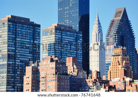 Skyline of midtown Manhattan in New York City with landmark skyscrapers. - stock photo