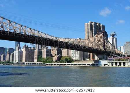 Skyline of midtown Manhattan with the Queensboro Bridge from across the East River. - stock photo
