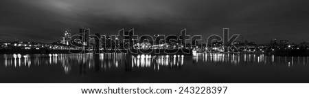 Skyline of Montreal in Panoramic View in Black and White picture at night - stock photo