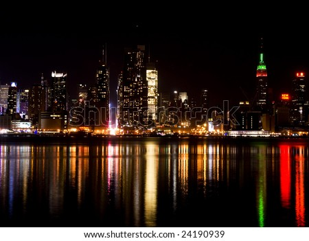 Skyline of New York City, from New Jersey. Featuring the lights from Time Square. - stock photo