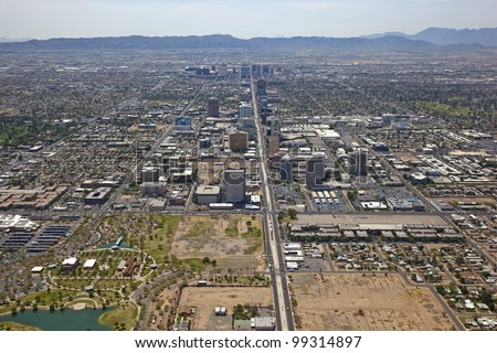 Skyline of Phoenix, Arizona looking south down Central Avenue from Indian School Road - stock photo