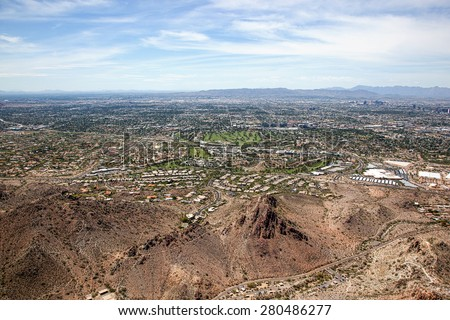 Skyline of Phoenix, Arizona looking south from above the mountain preserve - stock photo