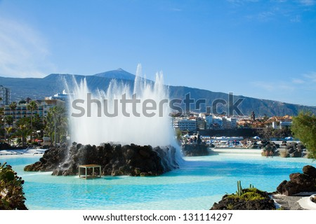 skyline of Puerto de la Cruz with Teide volcano and   fountain, Tenerife, Spain - stock photo