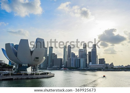 Skyline of Singapore bay with famous Downton Core at sunset. - stock photo