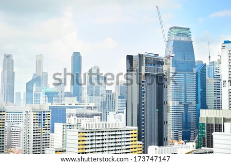 Skyline of Singapore downtown with a construction site on foreground - stock photo