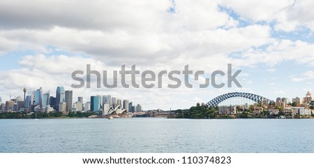 skyline of Sydney with city central business district and Sydney Harbour Bridge - stock photo