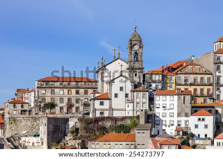 Skyline of the old part of the city of Porto, Portugal, with the Nossa Senhora da Vitoria Church. Unesco World Heritage Site - stock photo