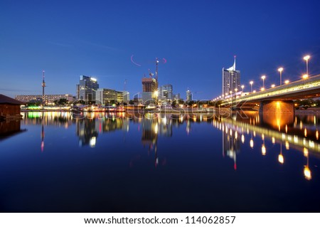 Skyline of Vienna and the Danube river - stock photo