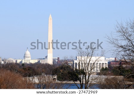 Skyline of Washington DC in winter, including the Capitol, the Washington Monument, and the Lincoln Memorial, as seen from Arlington, Virginia, across the Potomac River. - stock photo