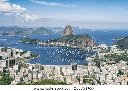 Skyline scenic overlook of Rio de Janeiro city with Sugarloaf Mountain Botafogo and Guanabara Bay - stock photo