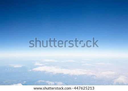 Skyline View above the Clouds from air on mountains - stock photo